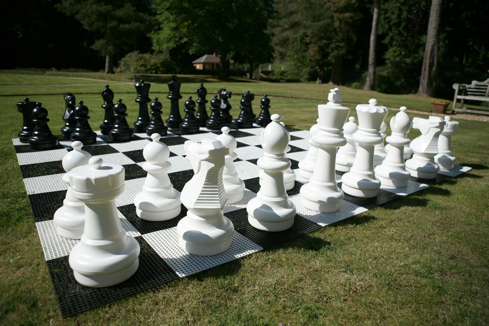 Chess Pieces And Board Jpg
